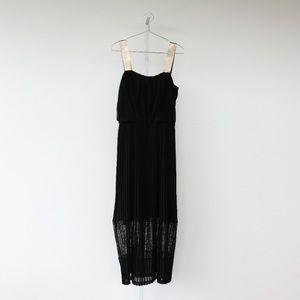 Sandro Paris black pleated maxi dress.